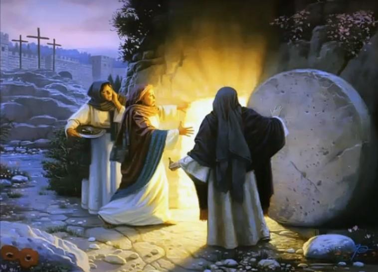 На фото женщины, открывшие пещеру, где было тело Иисуса Христа. Из пещеры виден яркий свет.