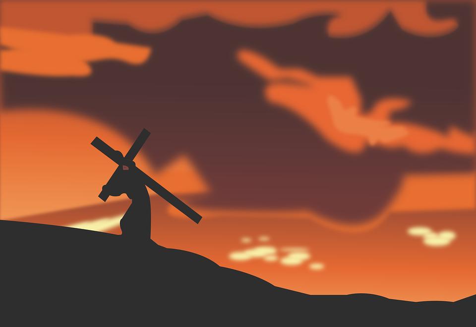 На фото Иисус Христос с крестом на спине.