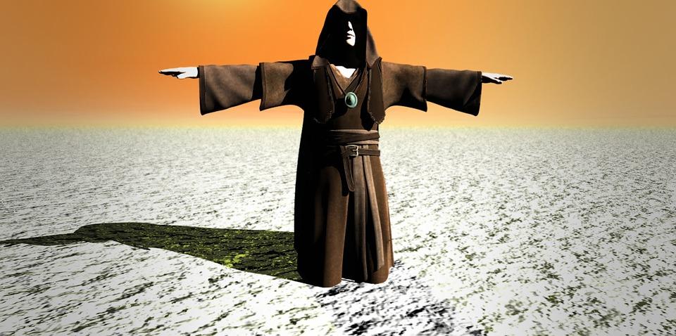На фото изображен священник, стоящий в пустыне.