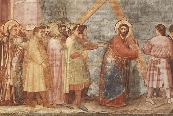 На фото изображено как Иисус идет на распятие.